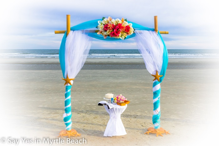 Blue and white tulle wrapped arbor